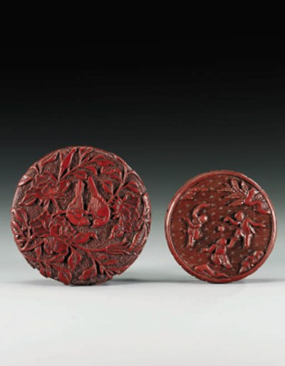 TWO CARVED RED LACQUER CIRCULA