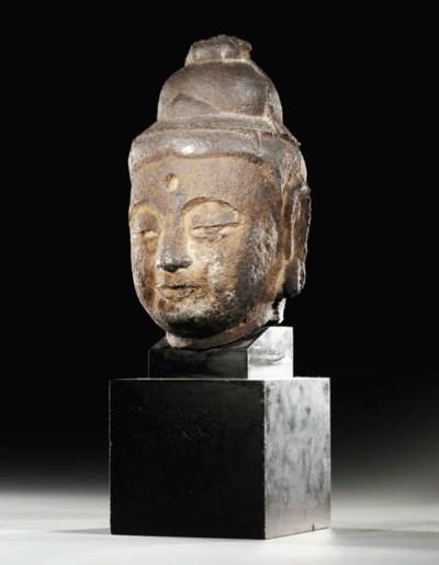 A CAST-IRON HEAD OF A BODHISAT