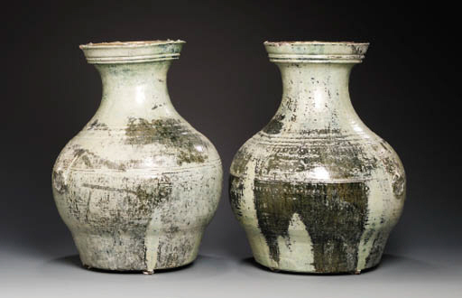 A PAIR OF LARGE LEAD GLAZED BA