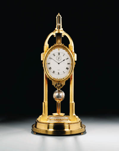 A Victorian gilt-metal month-going tripod table regulator with special seconds beating escapement