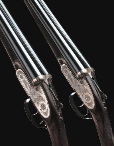 A PAIR OF 12-BORE SELF-OPENING SIDELOCK EJECTOR GUNS BY J. PURDEY, NO. 24225 (1) AND 24726 (2)