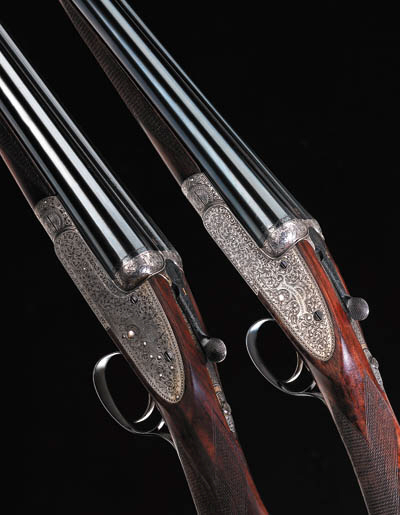 A COMPOSED PAIR OF 12-BORE SIN