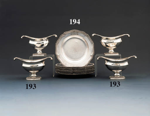 A set of four George III silver sauce-boats