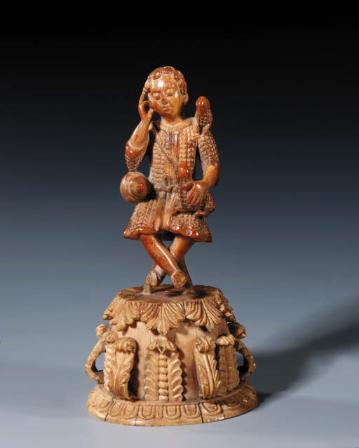 A CARVED IVORY FIGURE OF CHRIS