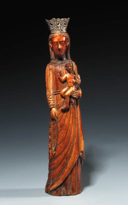 A CARVED IVORY AND SILVER FIGU