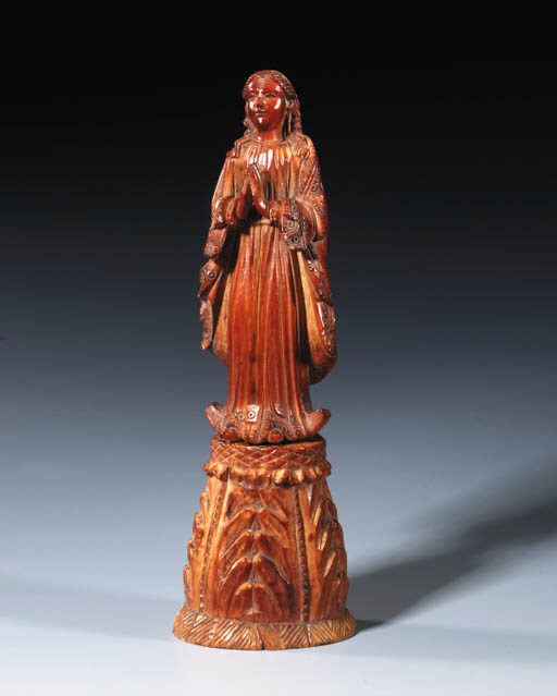 A CARVED IVORY FIGURE OF THE V
