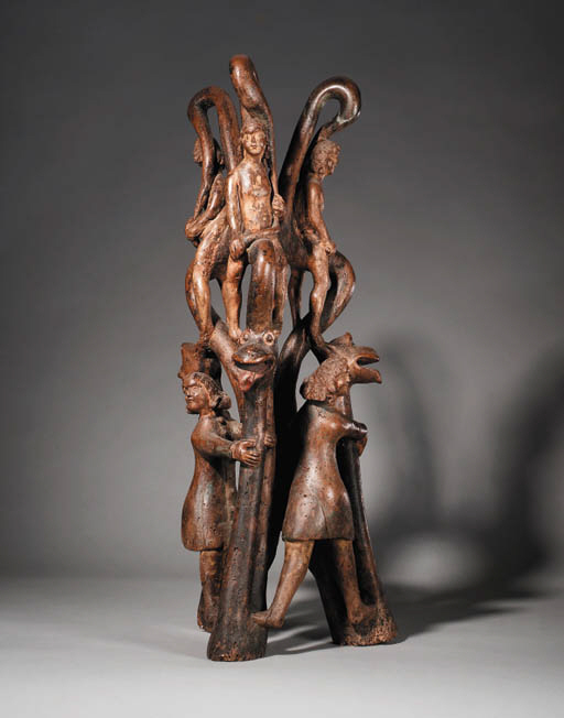 A CARVED WOOD TRIPARTITE GROUP