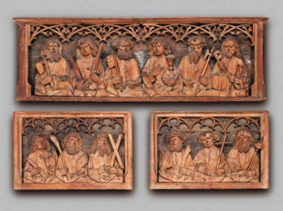 A CARVED WOOD TRIPTYCH DEPICTI