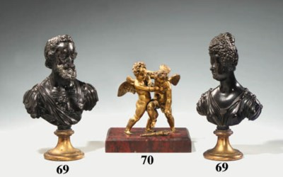 A GILT-BRONZE GROUP OF TWO PUT