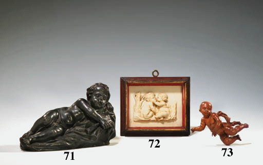 A CARVED BOXWOOD FIGURE OF A F