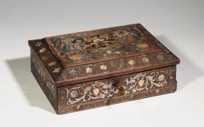 A CARVED WOOD CASKET WITH ENGR