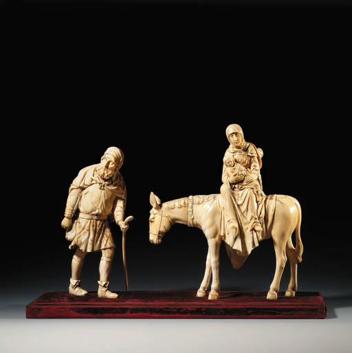 A CARVED IVORY GROUP OF THE FL