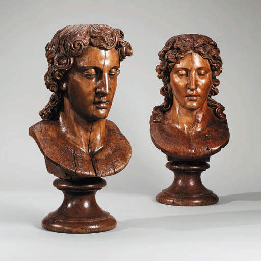 A PAIR OF CARVED WOOD BUST OF