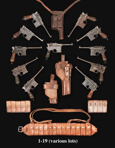 A GROUP OF LEATHER HOLSTERS AN