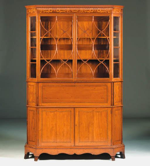 An inlaid walnut cabinet