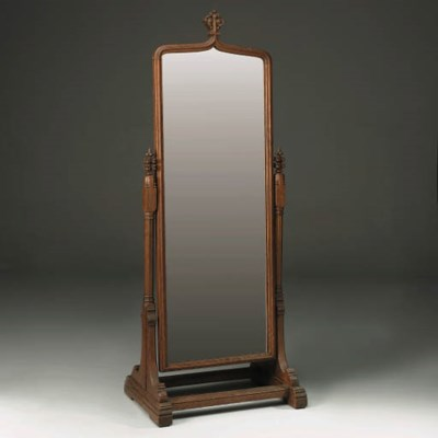 A Carved Oak Cheval Mirror