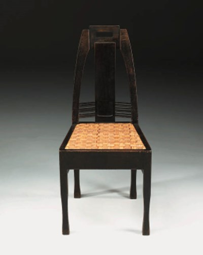 An oak and cane side chair