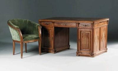 A carved oak pedestal desk and