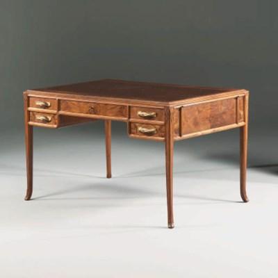 A Carved Walnut Desk