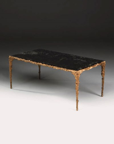 An ormulu and glass table