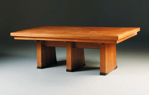 A cherrywood extending dining table
