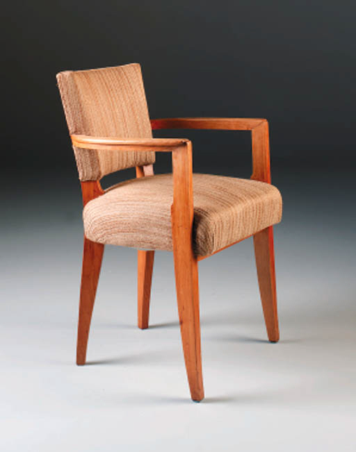 A set of eight cherrywood dining chairs