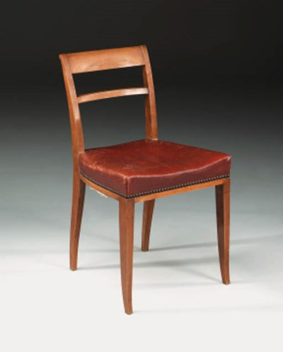 A sycamore and leather upholst