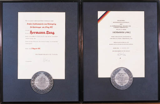 Two Special Award Medallions given by the German Minister for Transport in recognition of Herman Lang's achievements in the Carrera Panamericana and Nurburgring 25th Jubilee Grand Prix for sportscars; silver-plated bronze presented with signed certificates, mounted in matching display frames. 18x14 ins (46x36cm).