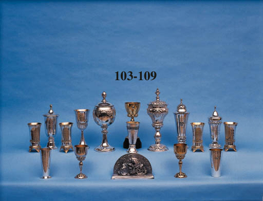 "Hill Climb Races, 1929-31; Allgemeiner Deutsche Automobil Club - A group of four fine trophy awards in the form of hand-beaten silver and silver-gilt beakers, raised on winged feet, incorporating the ADAC eagle motif; having applied ornate silver gilt plaques variously engraved and inscribed, including ""International Rennen Bergrekord 1929; Grosser Bergpreis von Deutschland 1930 & 1931""; for sidecar and combination events."