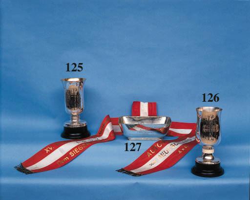 "Englebert Tyres - Nurburgring 25th Anniversary 1952; a large silver trophy cup awarded to Hermann Lang as the winner of Class'D' driving the Mercedes 300SL; engraved and inscribed ""Grosser Jubilaumspreis von Nurburgring fur Sportswagen, 3 Augut 1952, Der Sieger in Dem Rennen Klasse D."" Height 13ins (33cm)"