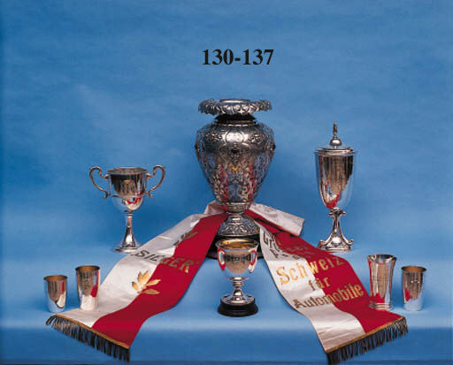 Swiss Grand Prix - Berne 1939; a superb hand crafted large silver trophy in the form of a classical vase; supremly created having various foliate and floral designs to all surfaces, hand engraved and chased, with applied relief designs incorporating ovate amber settings to body.