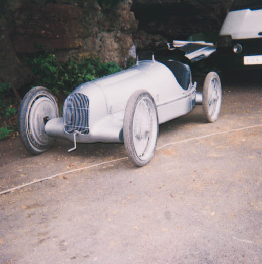 Mercedes-Benz W25 - A good children's motorized model of the pre-war Grand Prix car made legendary by Caracciola, Von Brauchitsch and Fagioli etc; beautifully constructed on steel chassis with silver-painted alloy panelled single-seater bodywork; pneumatic tyres on wire-spoked wheels, with four wheel brakes, Louvred bonnet, outside exhaust and fold-flat windshield; powered by a 49cc motocycle engine with electric start and centrifugal clutch; a fine example of the model makers skills. length approximately 8ft. (2.4m).