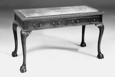 A mahogany writing table, earl