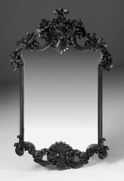 A carved oak mirror