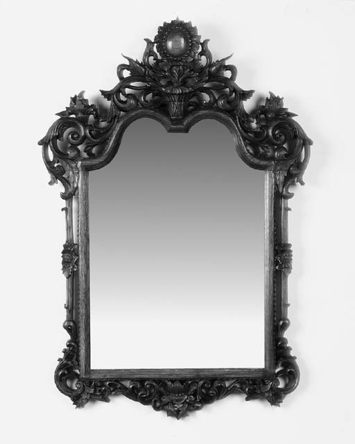 A pair of carved oak mirrors
