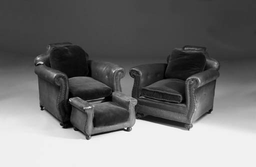A pair of Edwardian club armch