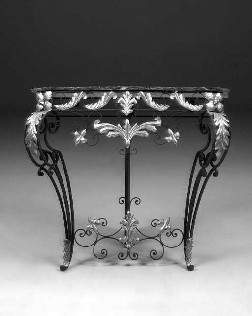 A pair of wrought iron and pre