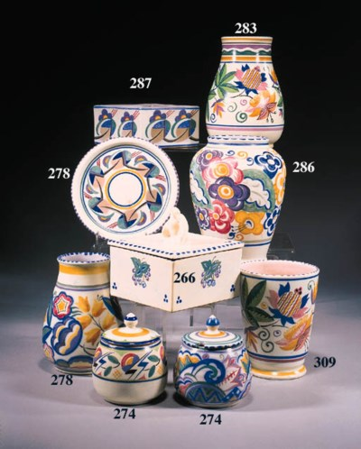 A cylindrical footed vase