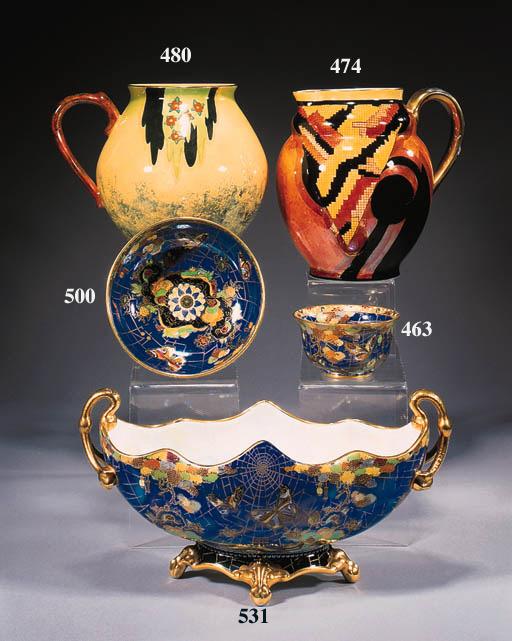 A twin-handled pedestal bowl