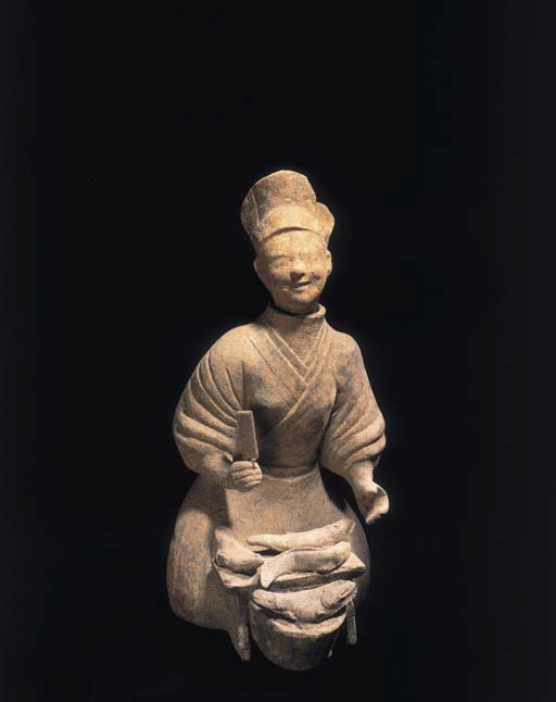 A Han pottery model of a cook