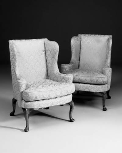 A pair of walnut and upholster