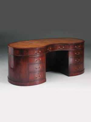 A mahogany kidney-shaped desk