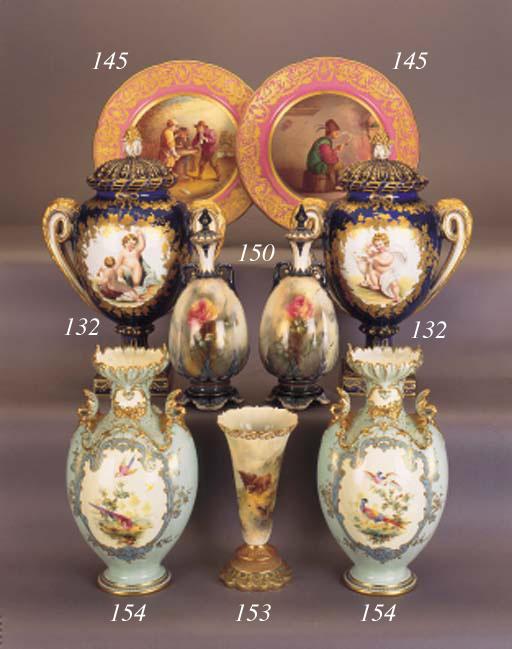 A pair of English porcelain pi
