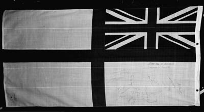 A white Ensign autographed by