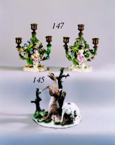 A pair of Meissen candlestick