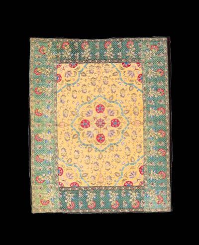 A prayer mat of yellow satin,