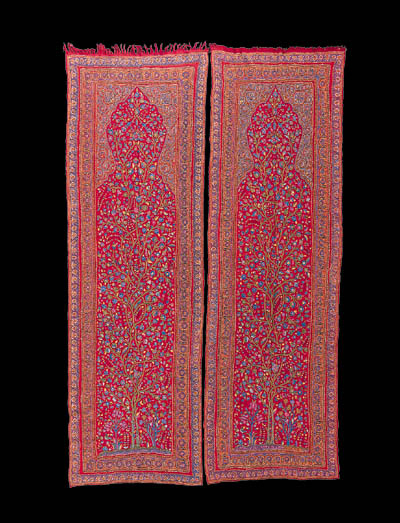 A pair of red wool prayer arch