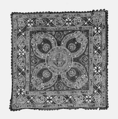 An embroidered coverlet