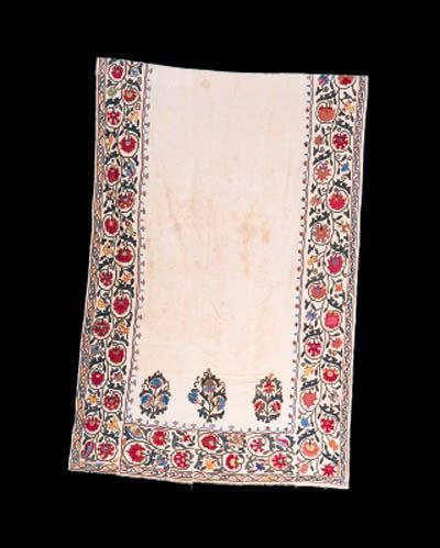 A susani mehrab of white cotto