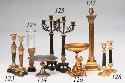 A brass Corinthian column tabl